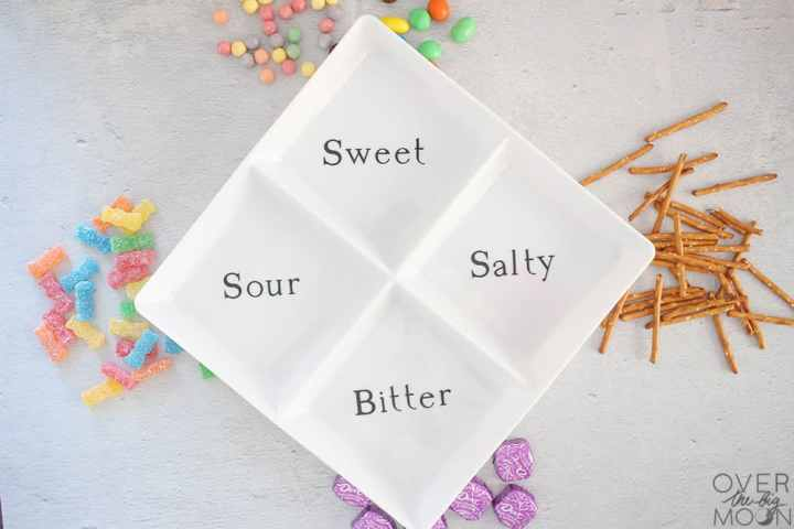 A snack tray with 4 squares and the words Salty, Sweet, Sour and Bitter in them.