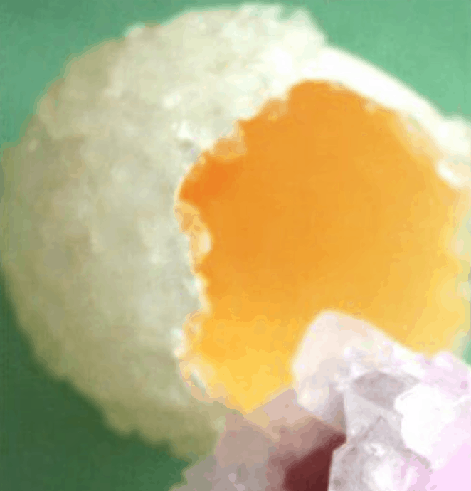 A crystalized Easter Egg that is yellow