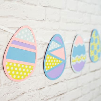 A fun and colorful Easter Egg banner using cut paper and an egg cut out.