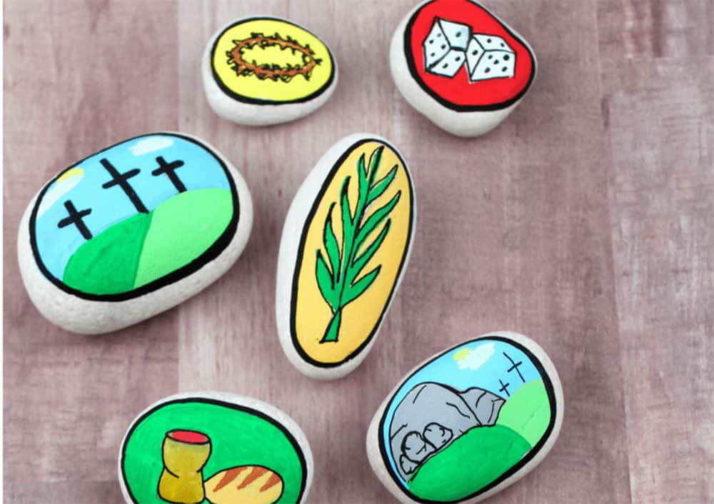 Rocks with painted pictures about Easter on them.