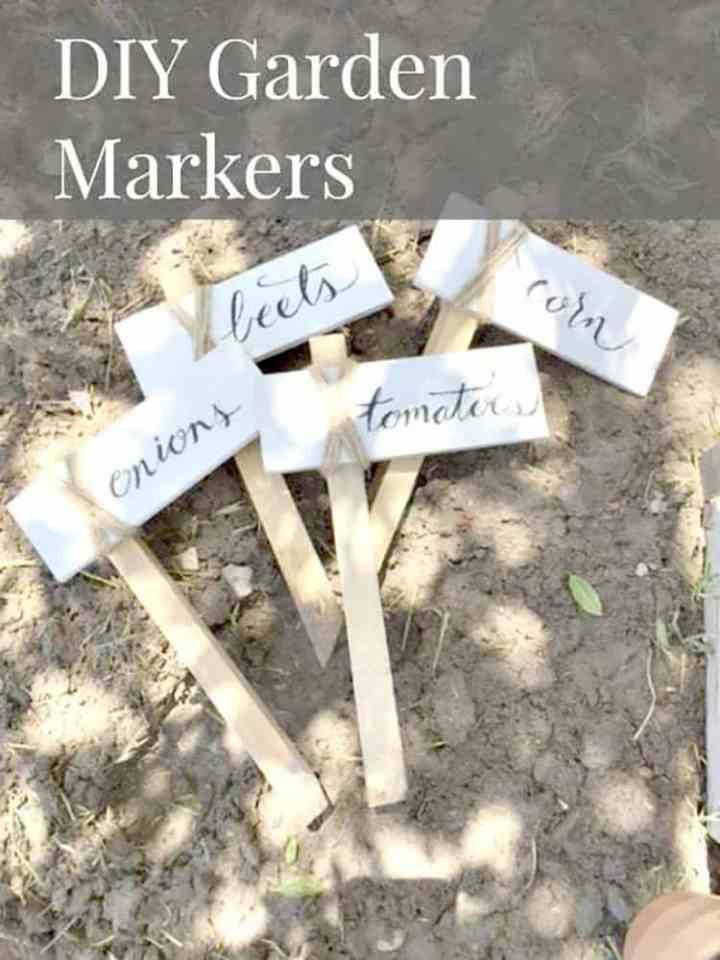 4 Garden Markers made from wood and twine that have the words beets, corn, tomatoes and onions on them.