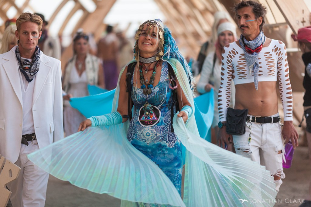 woman-with-blue-cape-smiling-at-the-opening-of-the-temple-of-whollyness-burning-man-2013-cargo-cult-black-rock-city-jonathan-clark (1)
