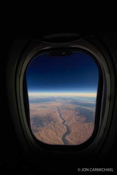 Great American Eclipse over the Oregon and Idaho border at 39,000 feet on Southwest Airlines flight. All rights reserved. Do not copy or sell print without permission from image creator Jon Carmichael.