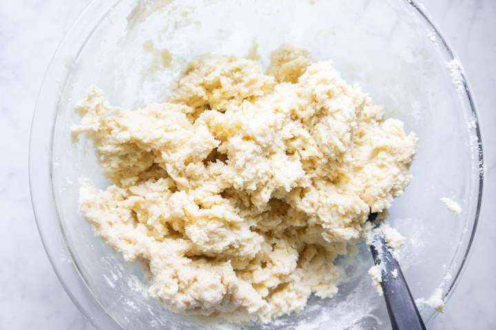 Mixing the dough for ricotta cookies