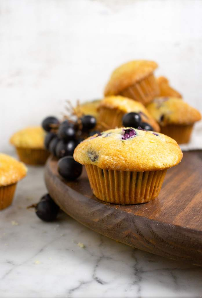 Grape muffins on a wood surface, baking with grapes