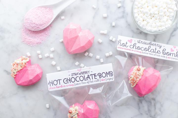valentines day hot chocolate bombs with strawberry milk powder and mini marshmallows