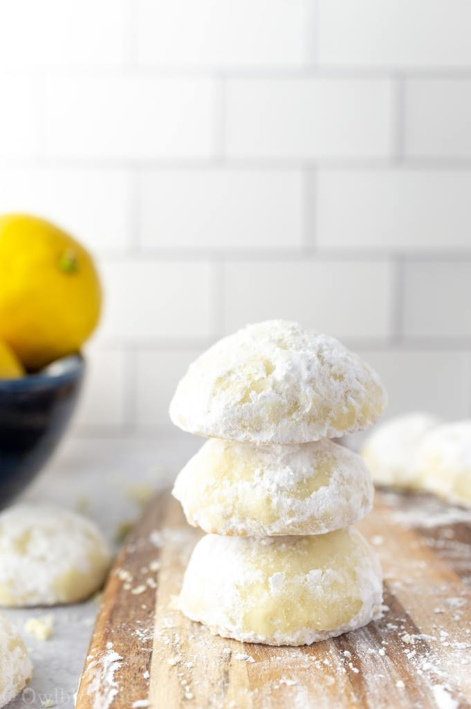 Lemon Cooler Cookies stacked on a wood board