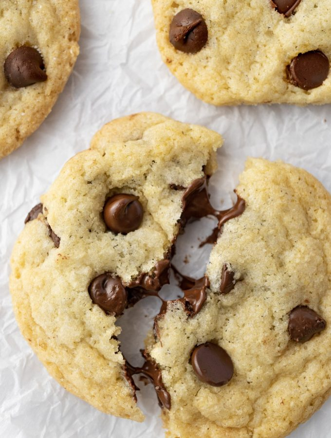 chocolate chip cookies without brown sugar broken in half with melted chocolate