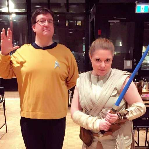 Image of Chris Rudram, founder of Enigmatic Events with a participant dresses in Star Wars costume.