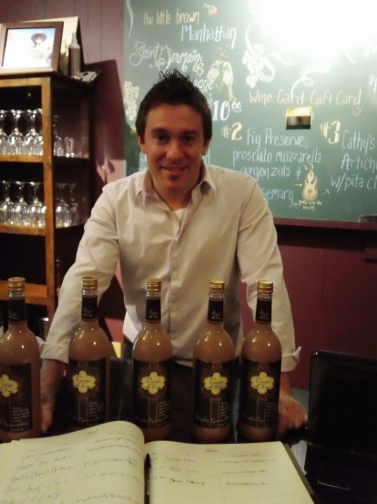 Aaron Straw of Vito's wine bar shows off the chocolate wine they served on the chocolate walk.