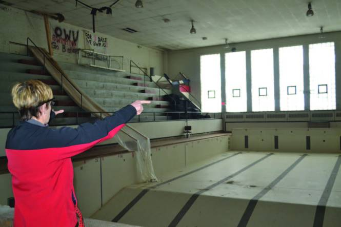 Nancy Knop points to the back area of the Natatorium where the Simpson-Querrey Fitness Center will be built. Photo by Breanne Reilly