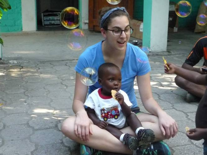 Sophomore Emma Drongowski blew bubbles with children on her Haiti mission trip. Photo from Facebook