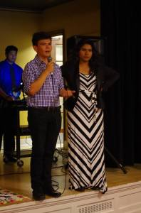 Sophomore Michael Mora-Brenes, vice president of Latin-American cultural club VIVA, speaks at the opening dinner for Hispanic Heritage Month. Sophomore Rosa Escobar, president, stands alongside. Photo by Spenser Hickey