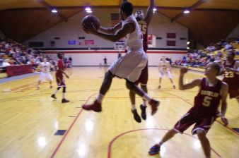 Junior wing Zak Davis passes the ball under the basket. Photo courtesy of Spenser Hickey.