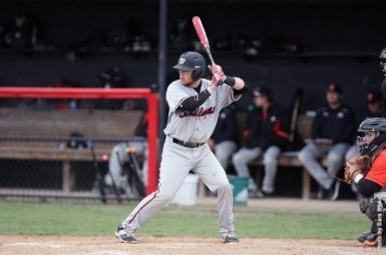 Freshman second baseman Colin Stolly prepares himself for a swing against DePauw. Photo courtesy of battlingbishops.com.