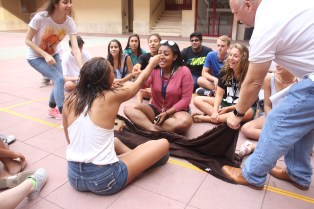 """Students learn each other's names during the """"blanket game""""."""