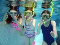 snorkelers in the pool