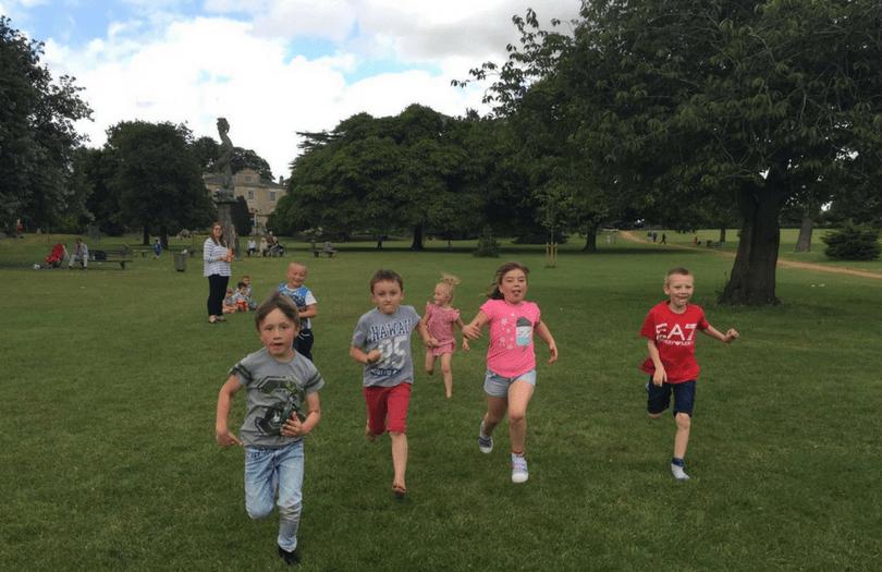 Children run towards the camera