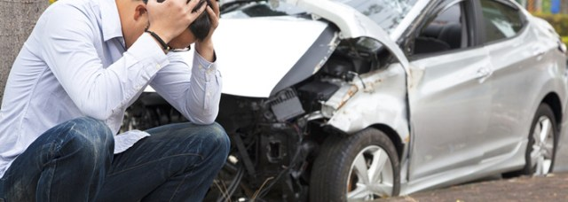 man and a wrecked car