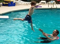 child jumps-off-diving-board
