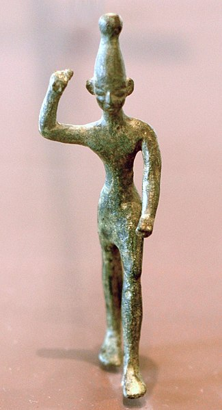 Bronze figurine of a Baal, 14th x 12th century BCE, found at Ras Shamra (ancient Ugarit) near the Phoenician coast. Musée du Louvre.