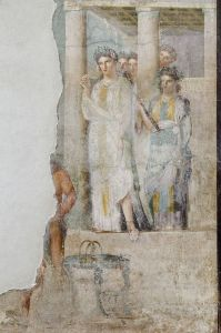 Iphigenia as a priestess of Artemis in Tauris sets out to greet prisoners, amongst which are her brother Orestes and his friend Pylades