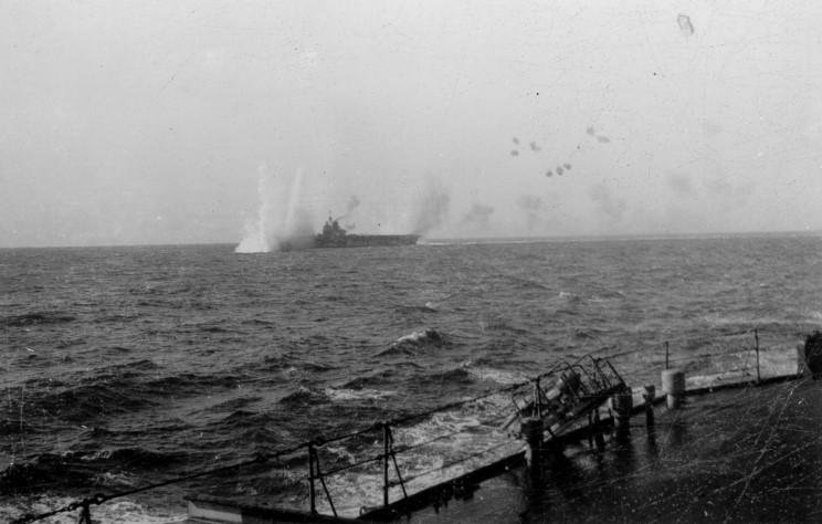 Luftwaffe have arrived in the Mediterranean: 25 German dive-bombers now attacking British aircraft carrier HMS Illustrious:86 seamen are dead on UK warship Illustrious- she's racing back to shelter of the British base on Malta, German planes in pursuit.
