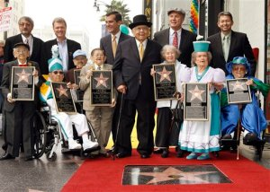 "Honorary Mayor of Hollywood, Johnny Grant, center with hat, honors The Munchkins from ""The Wizard of Oz"" as they receive a star on the Hollywood Walk of Fame at Grauman's Chinese Theatre, site of ""The Wizard of Oz's"" 1939 premiere, in Los Angeles Tuesday, Nov. 20, 2007. The Munchkins from left: Mickey Carroll, the Town Crier; Clarence Swensen, a Munchkin soldier, Jerry Maren, part of the Lollipop Guild; Karl Slover, the Main Trumpeter; Ruth Duccini, a Munchkin villager; Margaret Pelligrini, the ""sleepyhead"" Munchkin and Meinhardt Raabe, the coroner. Back row from left: Ted Bulthaup, sponsor of the star and owner of a Trip to the Movies Theatre in Chicago, Los Angeles City Council President Eric Garcetti, Tom LaBonge, LA Councilman and Leron Gubler, President/CEO Chamber of Comerce. (AP Photo/Damian Dovarganes)"