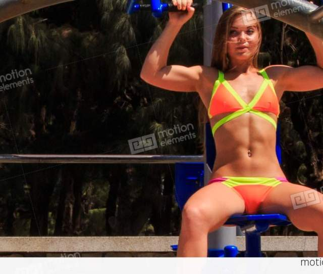 Blonde Girl In Bikini Trains Actively On Weight Stack Stock Video Footage
