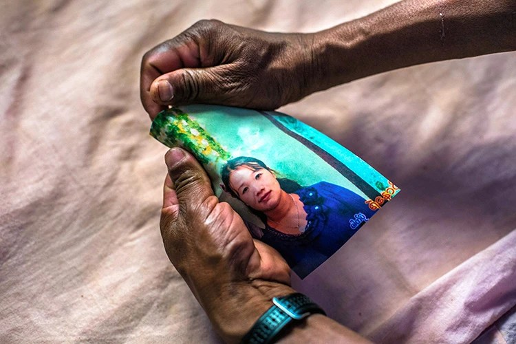 The father of Nyo, an ethnic Wa girl who became a victim of human trafficking, holds a picture of the accused broker Daw Hnin Wai who has been fleeing at large with a police warrant, in Mong Yal, Myanmar, March 30, 2019. With women far outnumbered by men in China, some Chinese men are importing wives from neighboring countries, and using force to do so. (Minzayar Oo/The New York Times)