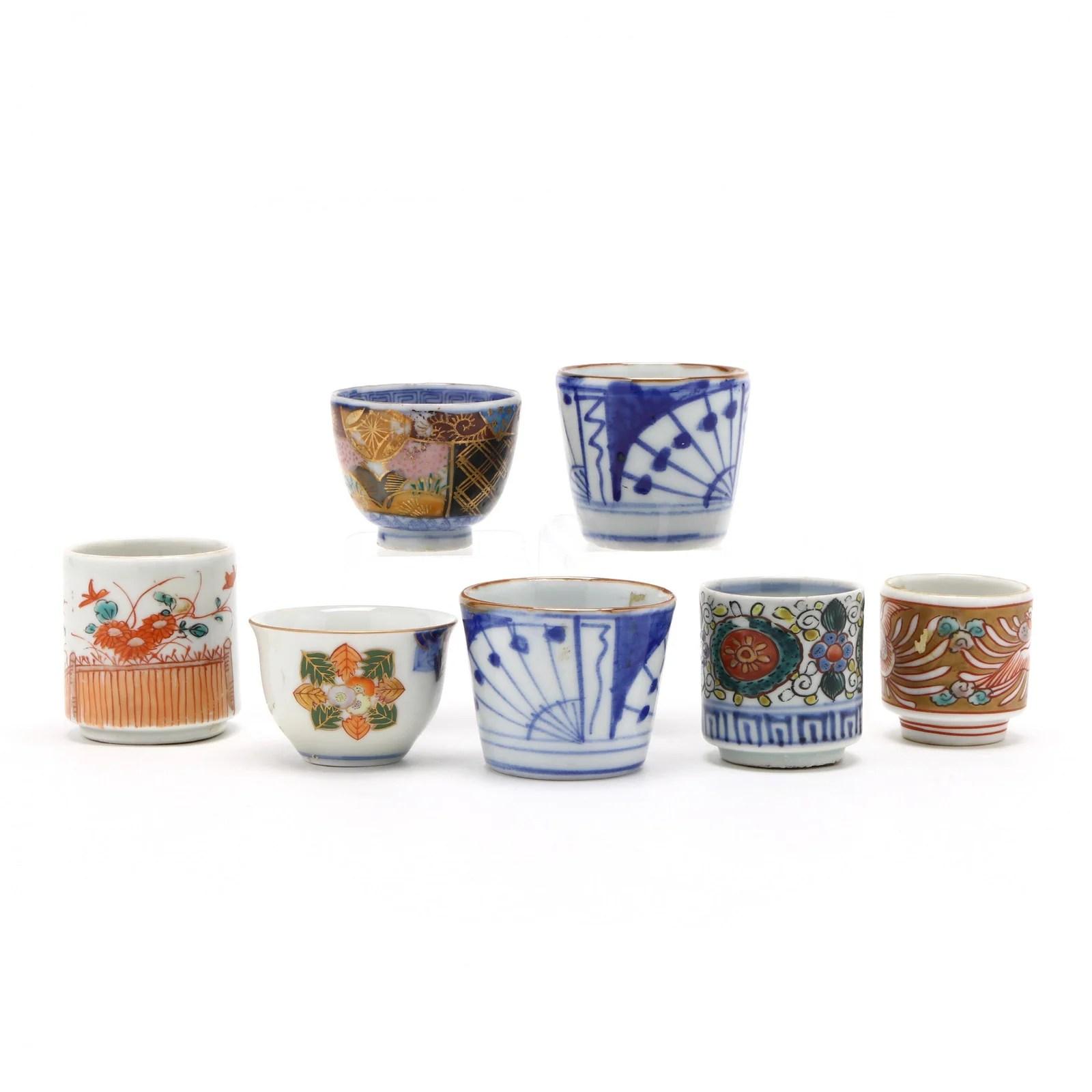 A Group of Seven Japanese Porcelain Sake Cups