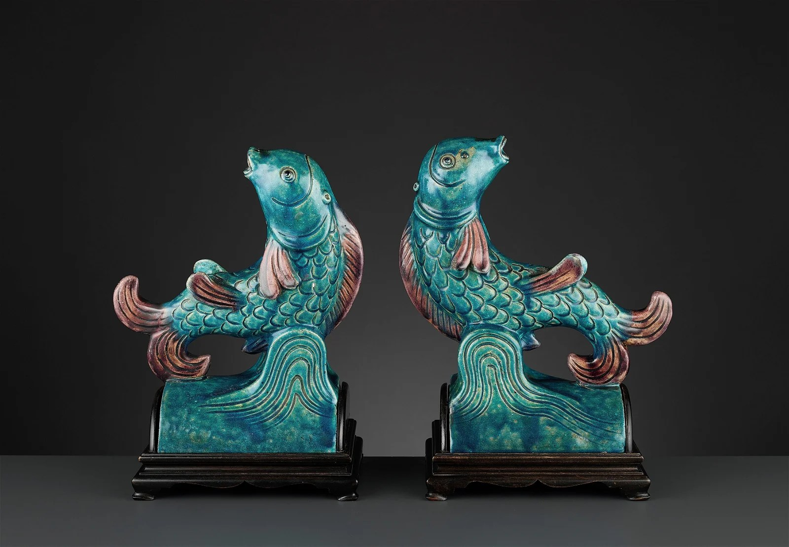 TWO AUBERGINE AND TURQUOISE GLAZED ROOF TILES,MING