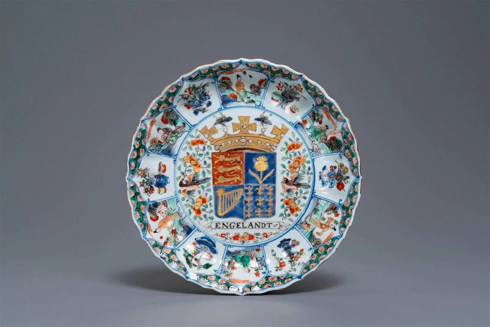 A Chinese famille verte 'Provinces' dish with the arms