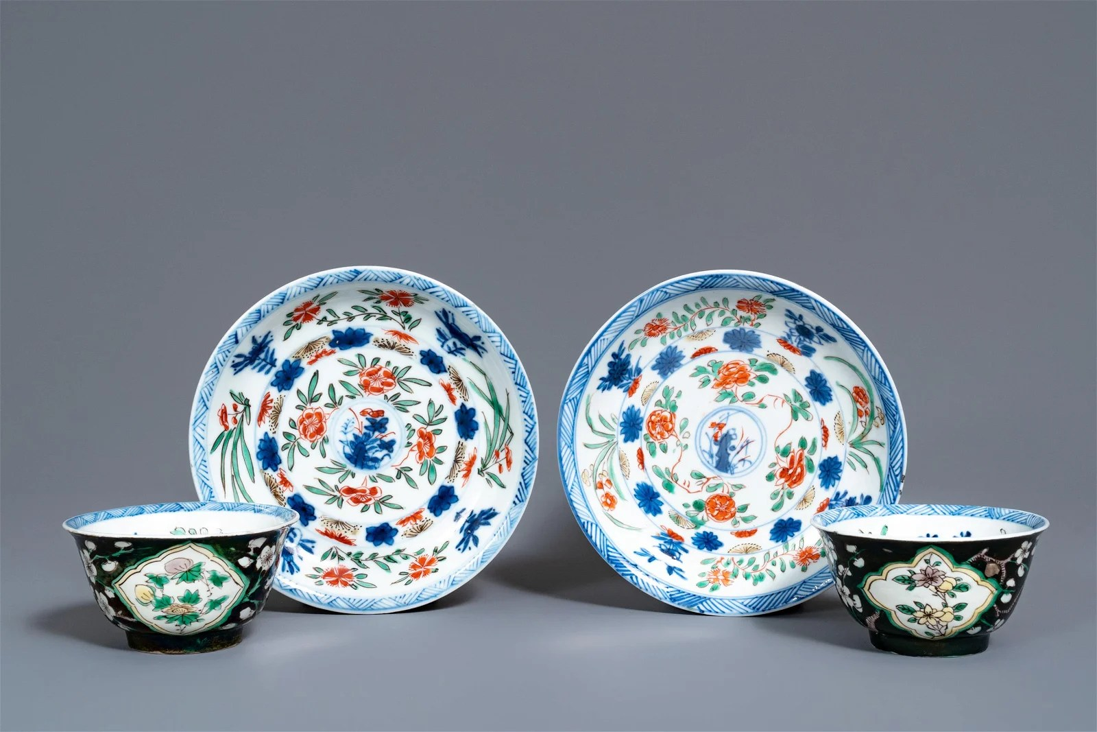 A pair of rare Chinese famille noire cups and saucers,