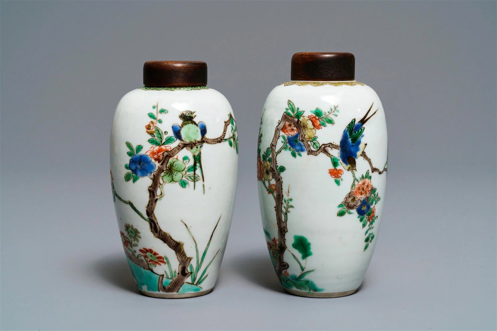 Two Chinese famille verte vases with birds on