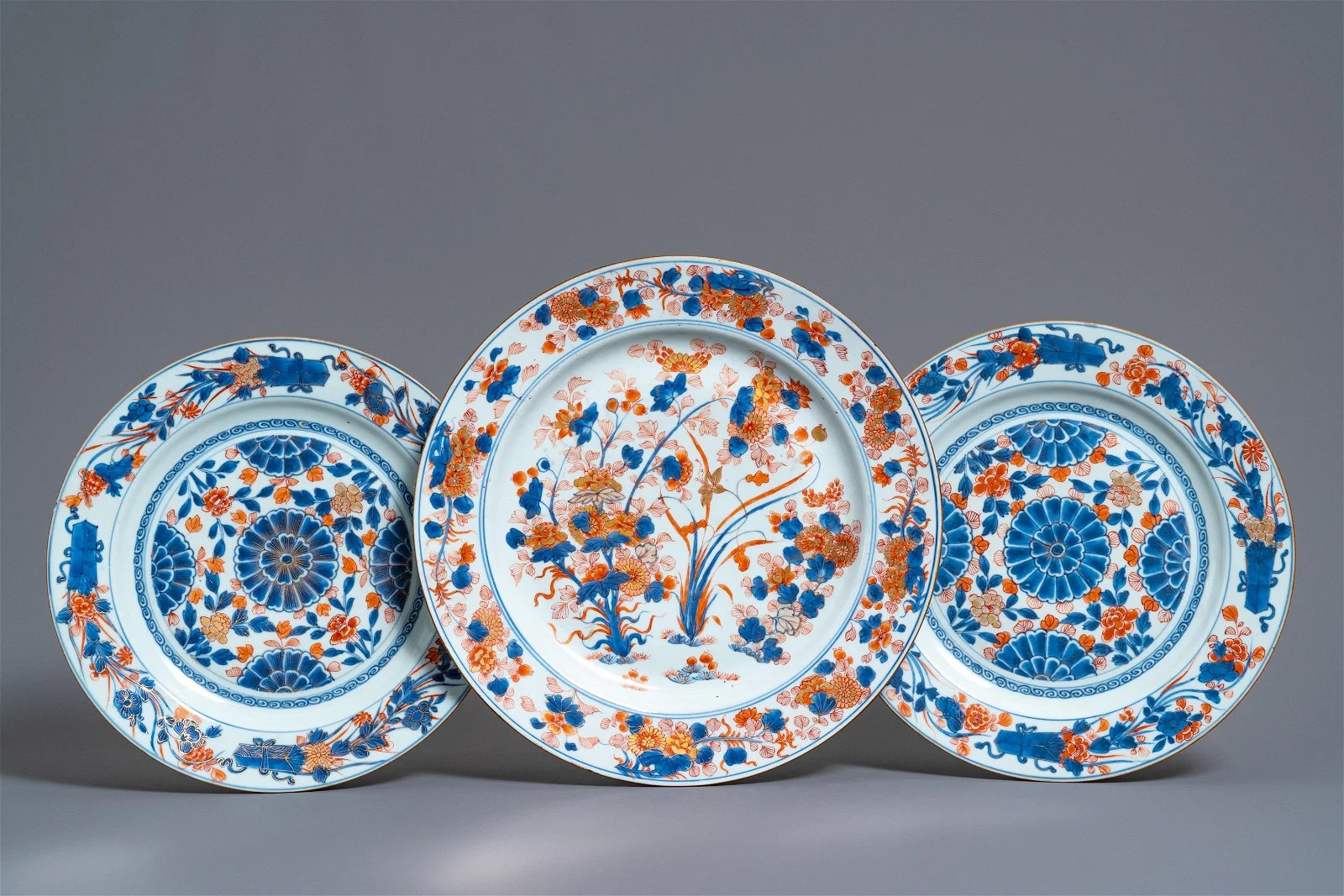 Three Chinese Imari-style chargers with floral design,