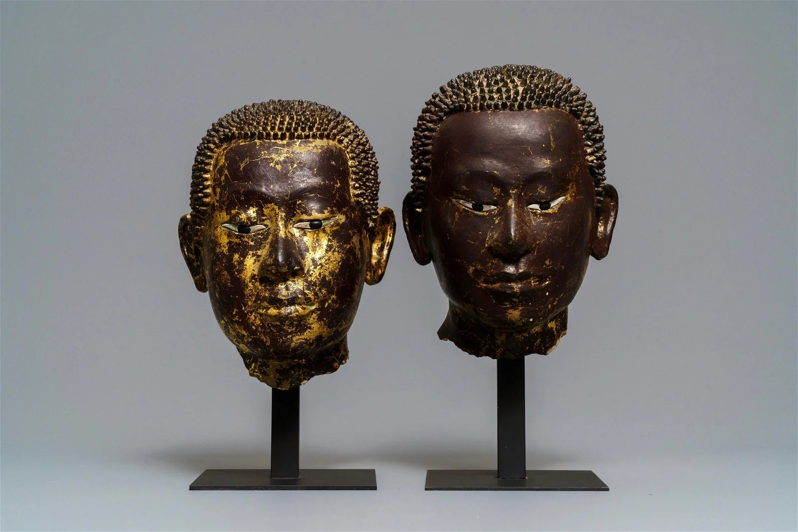 Two gilt-lacquered terracotta and stucco Buddha heads