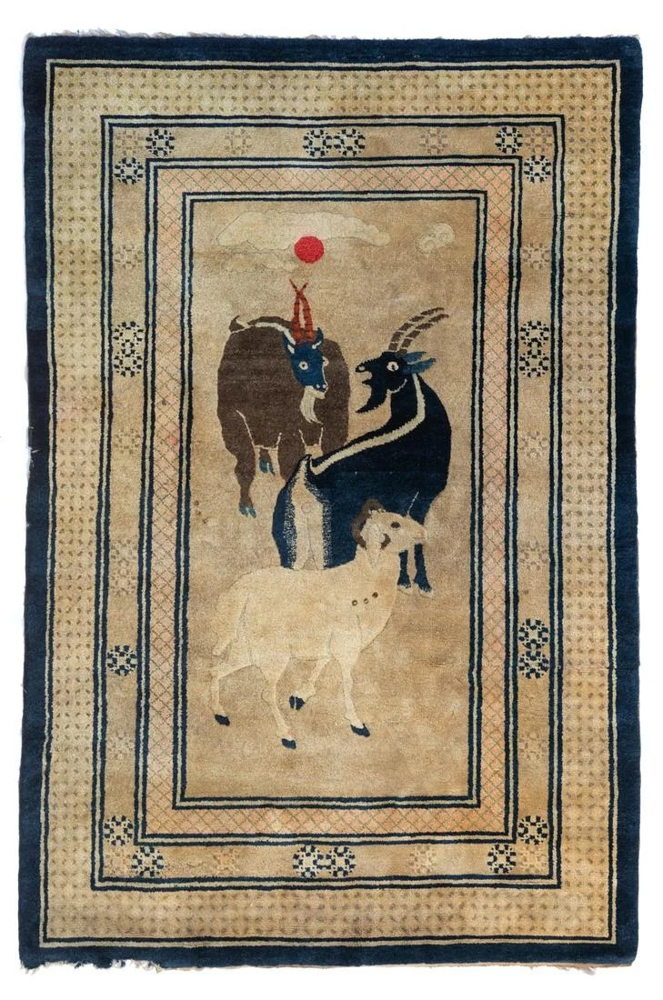 A Chinese woollen rug, decorated with goats, 195 x 129