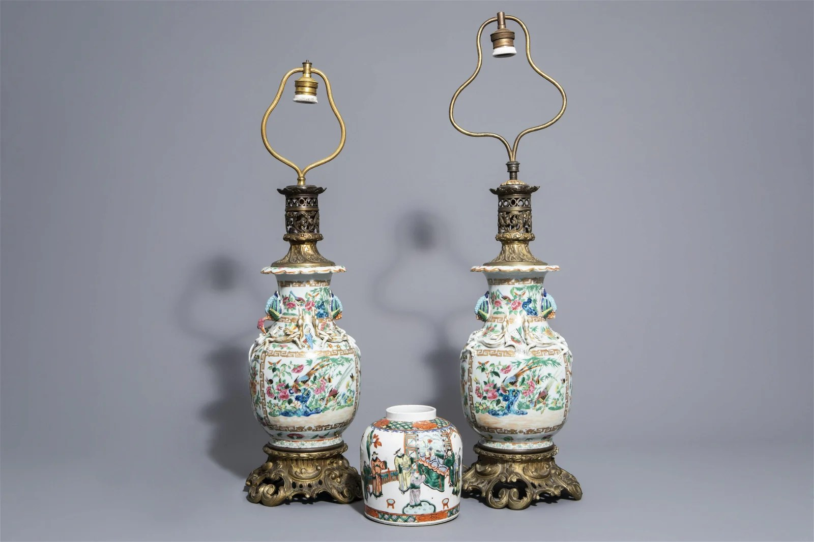 A pair of Chinese Canton famille rose vases mounted as