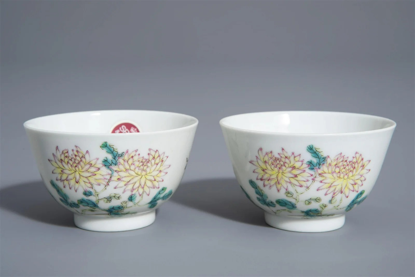 A pair of Chinese famille rose 'floral' cups, Guangxu