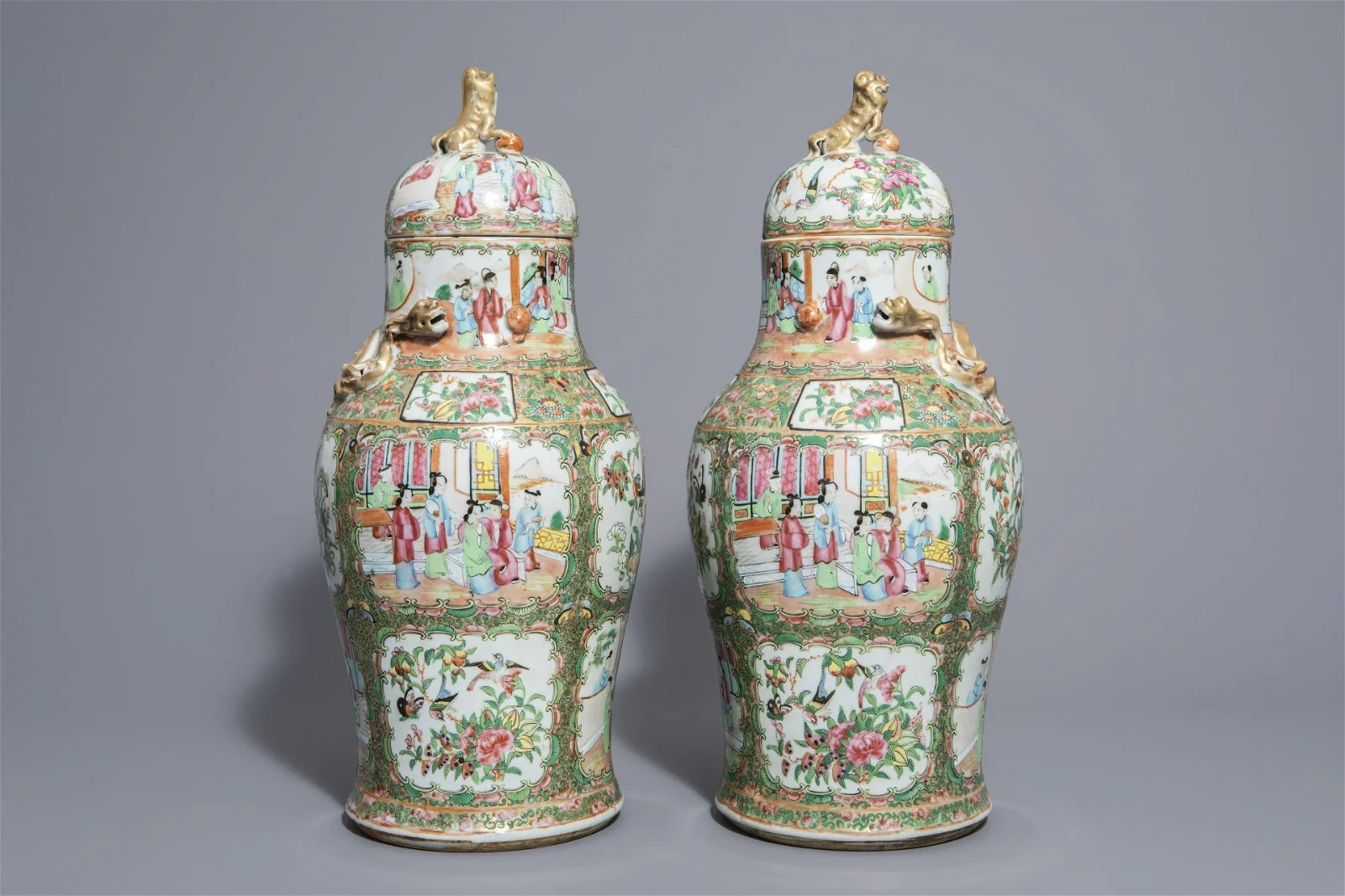 A pair of Chinese Canton famille rose vases and covers,