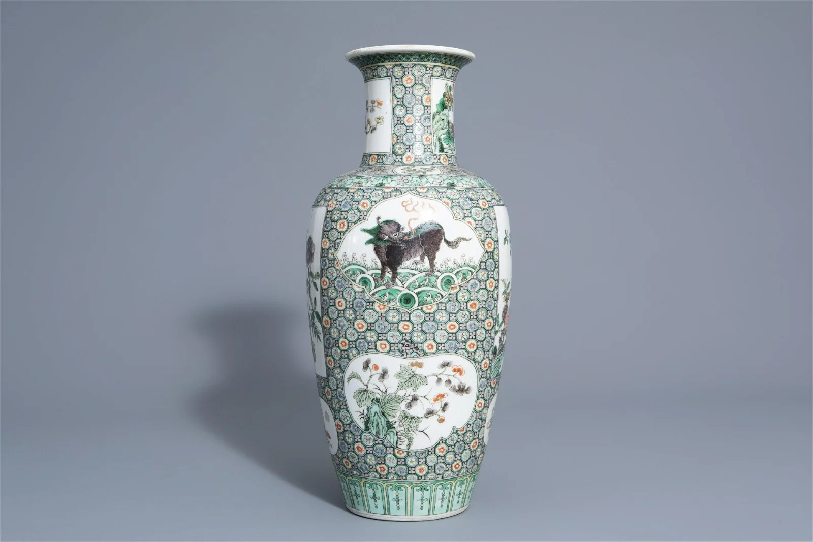 A Chinese famille verte vase with mythical beasts and