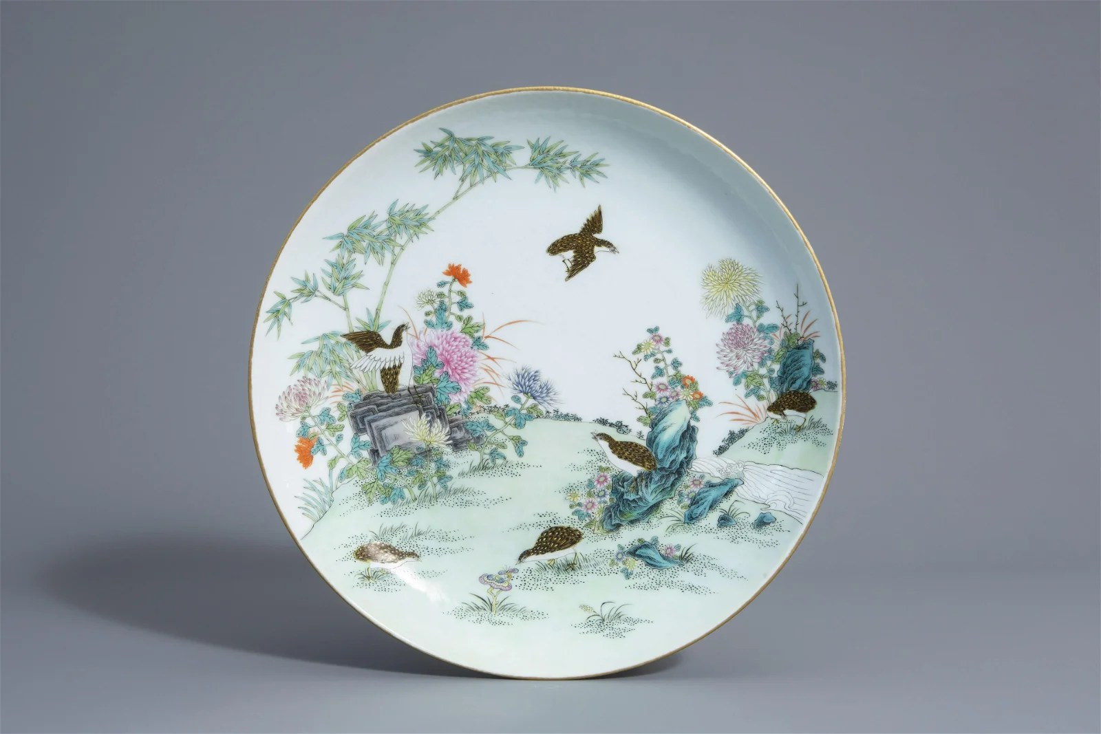 A Chinese famille rose charger with quails among flower