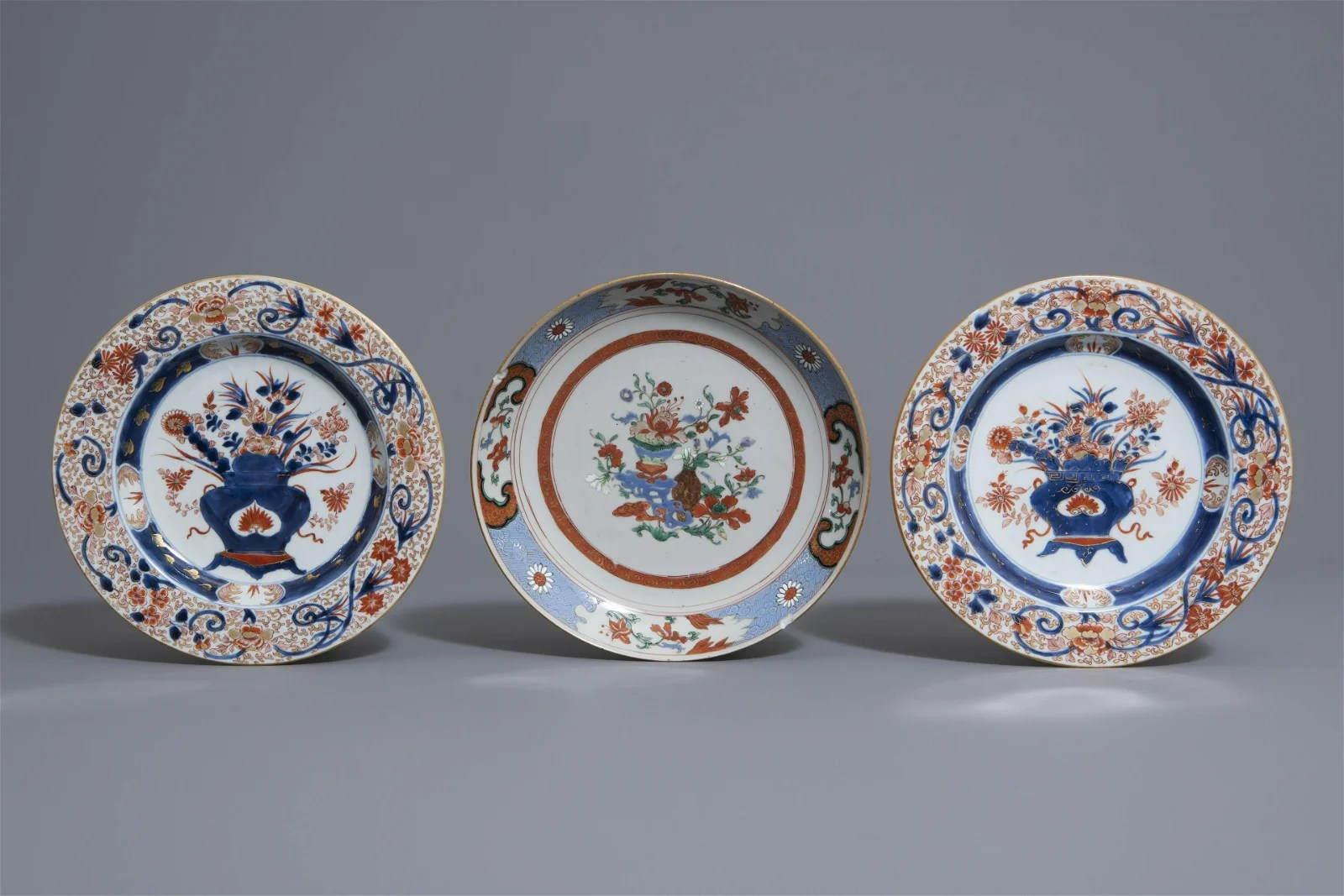 Three Chinese famille rose and Imari style plates,