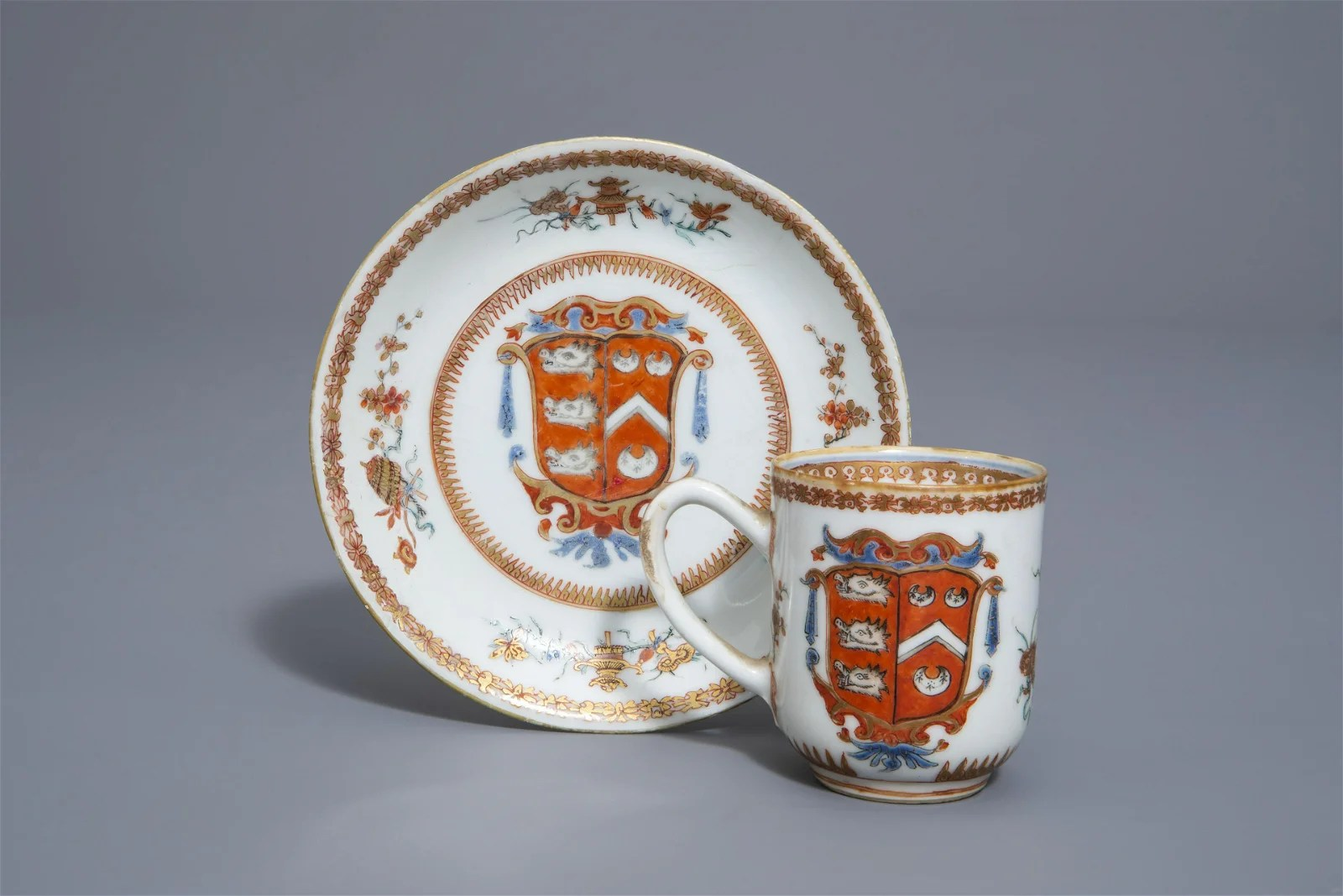 A Chinese export armorial cup and saucer with the arms