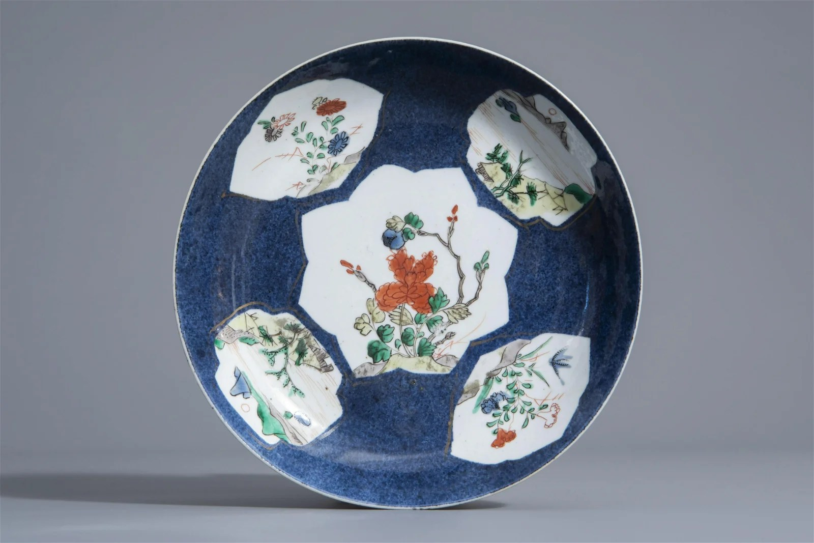 A Chinese famille verte powder blue ground dish with