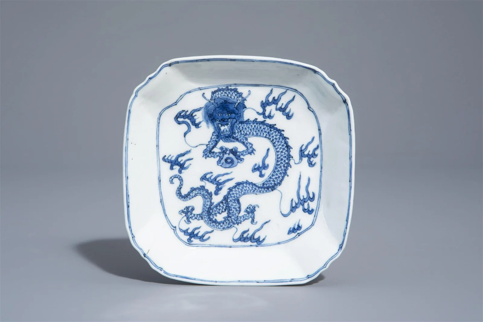 A Chinese blue and white square 'dragon' plate, Ding