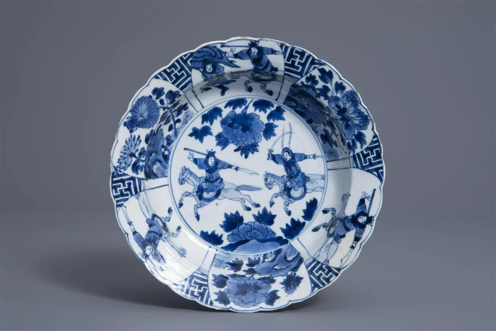 A Chinese blue and white horseriders plate, Kangxi mark