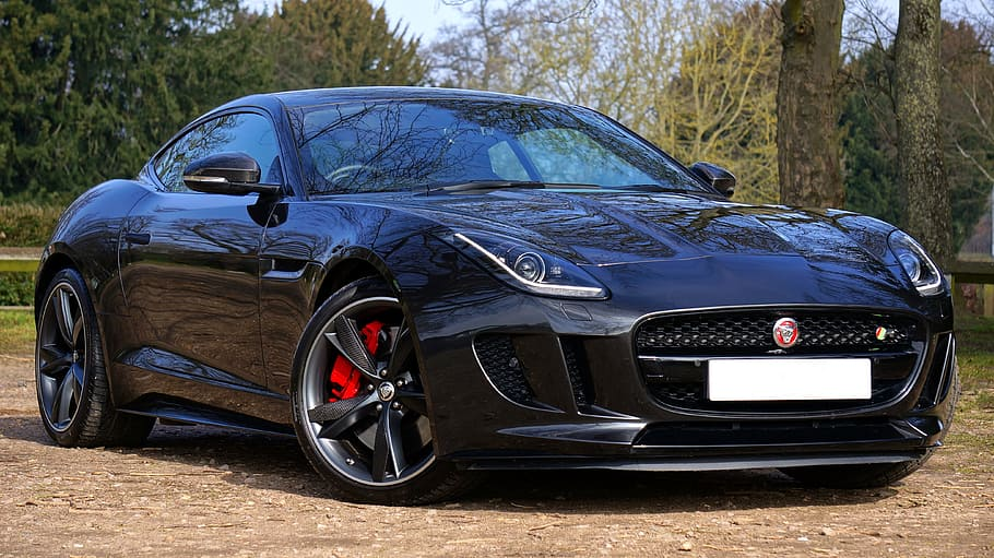 When asked about hybrid systems in the past, jaguar chief product engineer for sports cars erol mustafa said the brand didn't have plans to use them to improve performanc. Black Jaguar F Type Coupe Parked Tree Jaguar Sports Car Fast Automobile F Type Luxury Pxfuel