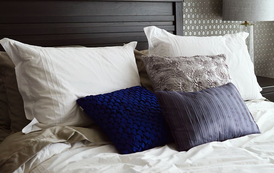 assorted color pillows bed pillows